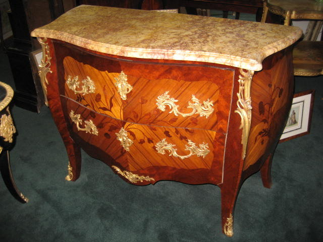 French Nineteenth Century Large Two Drawer Marble Top Bombe Commode With Marquetry Work Throughout And Ormolu Mounts
