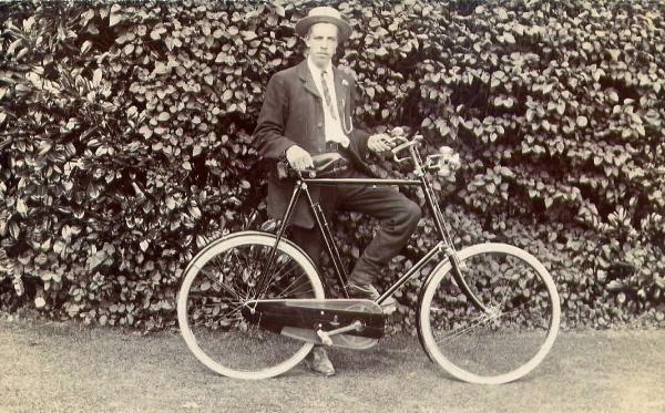 Young Man with Bicycle, Against Hedge