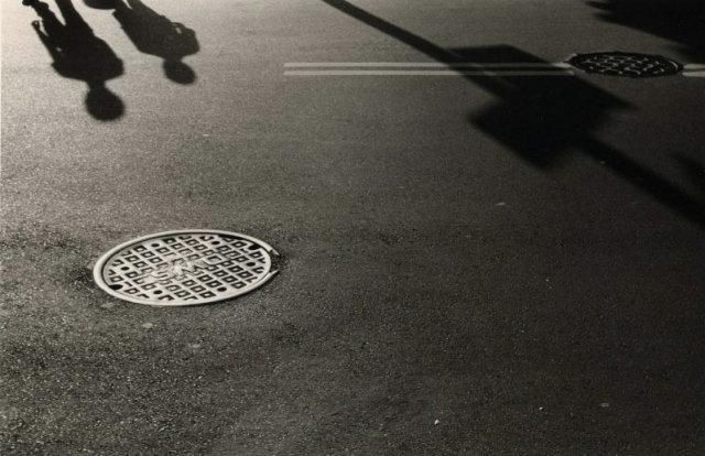 Jerry Stiles: Untitled (Manhole Cover and Shadow)