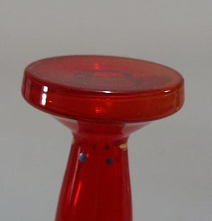 Red purfume with enamel and gold design.