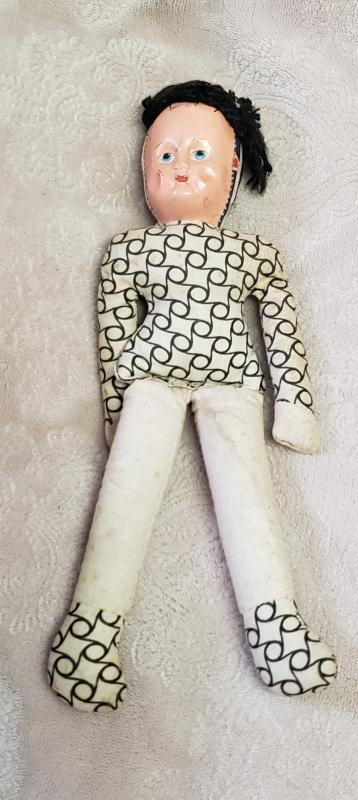 Little sewing machine and hand stiched doll,