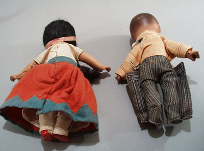 Pr of Composition dolls, larger souvineer type.