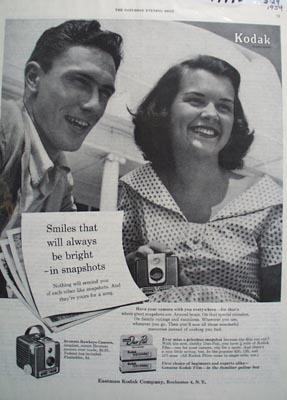Kodak Smiles always bright Ad 1954