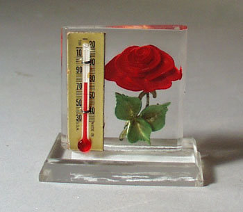 Lucite holder Thermometer with red rose.