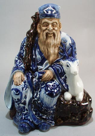 Wise Oriental man & reindeer, old, has cloth impressed bottom