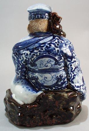 Wise Oriental man & reindeer, old, has cloth impressed bottom