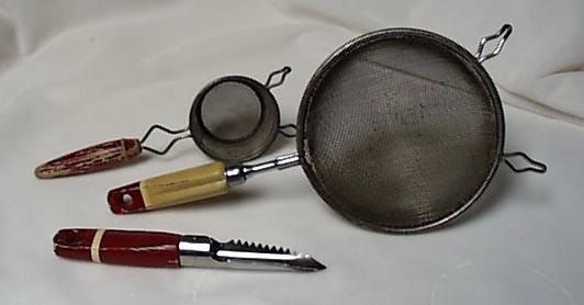 3 red handled utensils