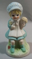 Porcelain Girl Figurine With Flower Bouquet