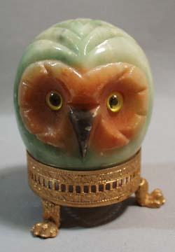 Marble egg shaped owl with ornate gold base