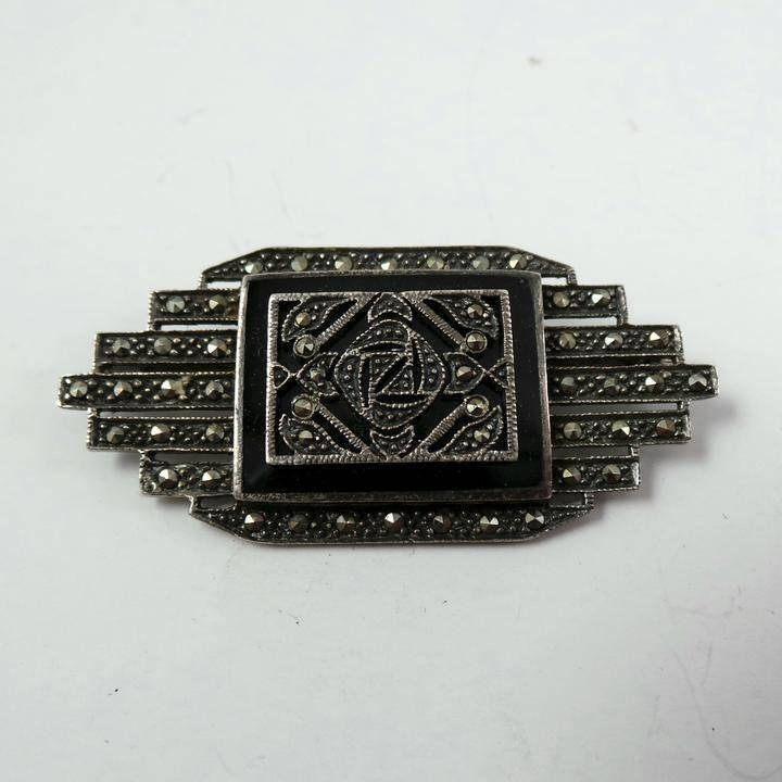 Antique sterling silver and marcasite brooch.