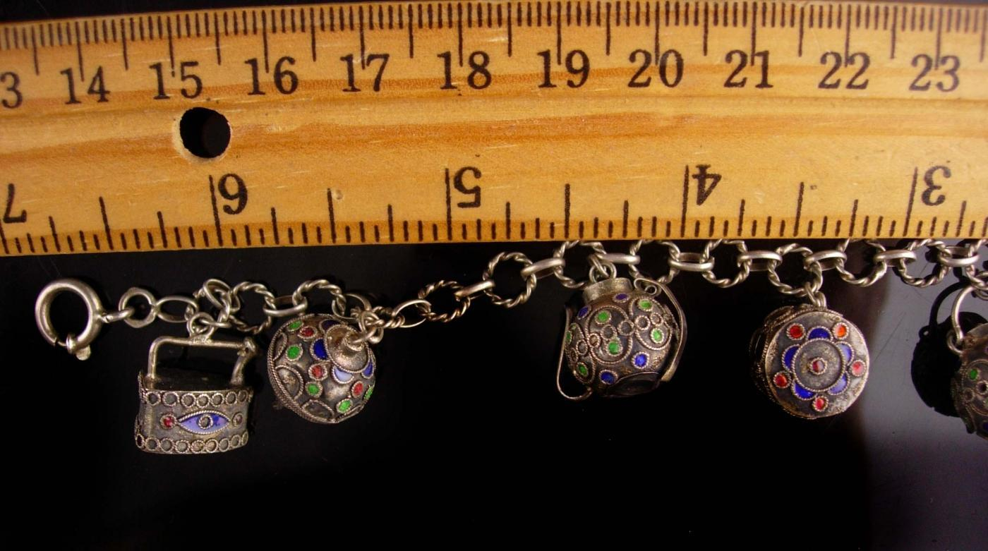 Antique 800 Silver charm bracelet - asian dice - oriental teapot - vintage toy top - miniature iron -