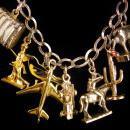 Vintage Sterling 16  Charm Bracelet - movable slot machine - perfume - airplane - oil well - southwest theme - racecar - statue liberty