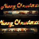 Vintage animated Merry Christmas sign Musical light up Rotating scenes and music Christmas decoration