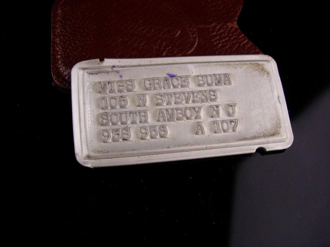 Early Bloomingdales Charge Plate - vintage metal credit card - Miss Grace Suma - Fashion history - Japanese American - metal id badge
