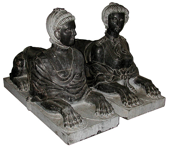 68.5867 Pair of Black Marble Sphinxes.