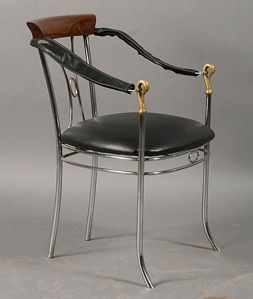 7401 A stylish set of four chrome and bronze chairs, each having swan decorated arms and upholstered seats circa 1920.