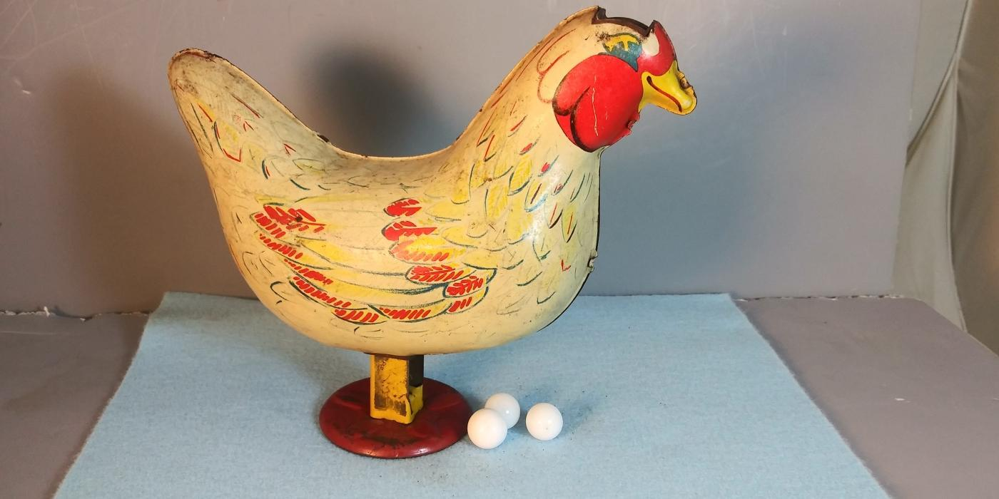 toy tin chicken