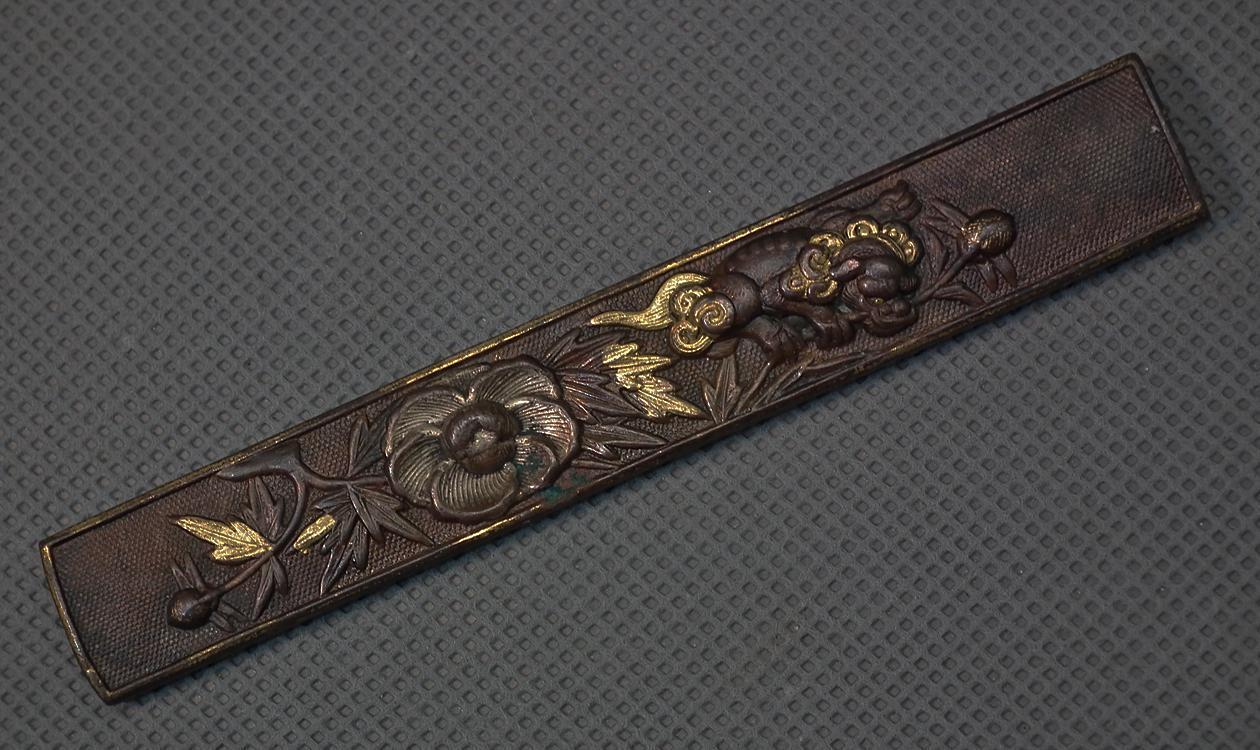Antique Japanese Samurai Knife Handle Kozuka With a Buddhist Lion Shishi & Floral Pattern