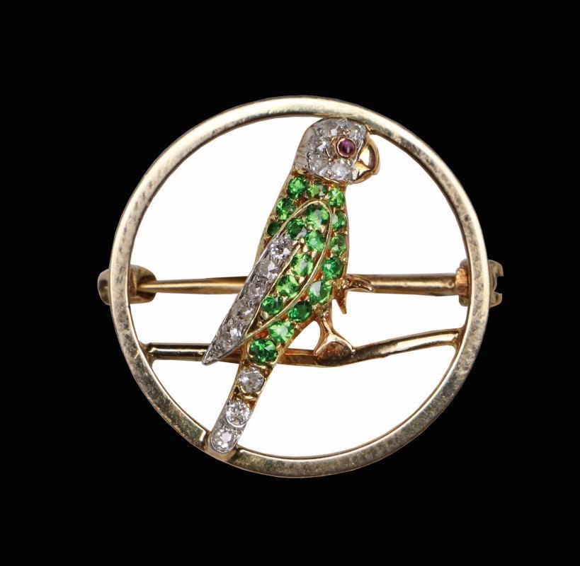 Demantoid, Diamond and Ruby Parrot Pin, C.1920.