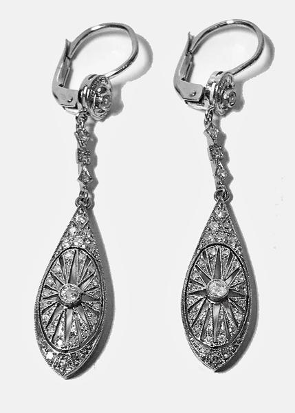 Pair of Art Deco Platinum and Diamond drop Earrings, C.1915.