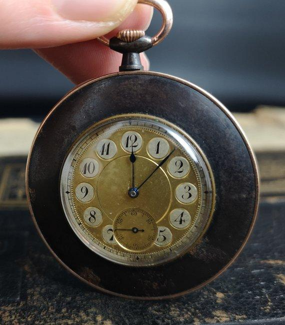 Antique gold and gunmetal pocket watch, working