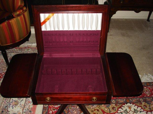 Drop leaf silver storage table
