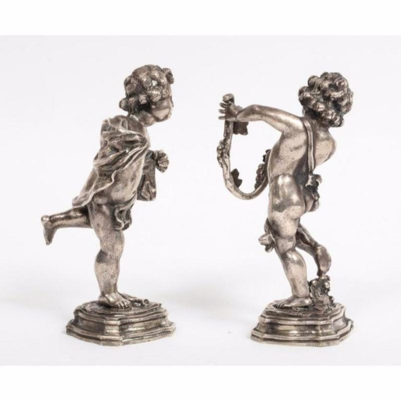 Mario Buccellati, a Pair of Sterling Silver Figures of Playful Children Cherubs