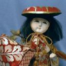 Oriental Geisha Girl Doll holding Silken Pouch - Vintage Ethnographic Figurine