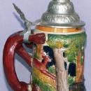 German, Pottery Covered Beer Stein with Fox Handle &  Animal and Forest Background