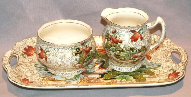 Exotic Design Porcelain Creamer and Sugar on Tray
