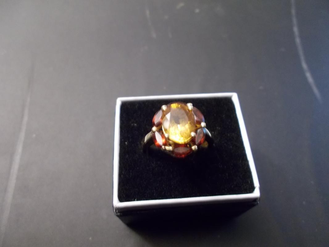 Ladies 14 Karat Yellow Gold Ring Containing One Oval Cut Citrine and Surrounded by Six Marquis Cut Madera Citrines