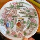 Japanese Kutani ware plate made in the 1930s with iron red geisha scene