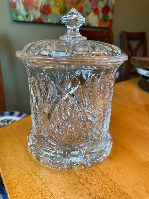 This is a vintage 1970 to 1980s pressed glass candy jar with lid