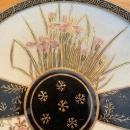 A Japanese Satsuma plate made in the 1880 to 1912 Meiji period, floral pattern