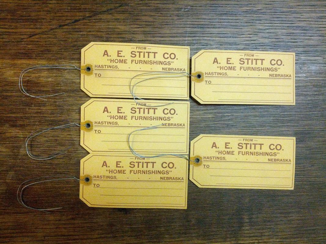 A E STITT COMPANY HOME FURNISHINGS CARDBOARD TAG HASTINGS NEBRASKA BUSINESS ADVERTISING TICKET DENISON IOWA USA MADE LABEL
