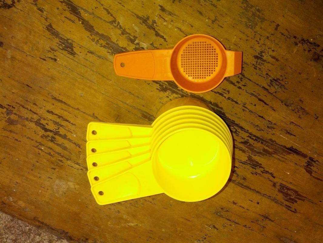 yellow tupperware stacking style measuring cup orange plastic strainer utensil kitchen tool
