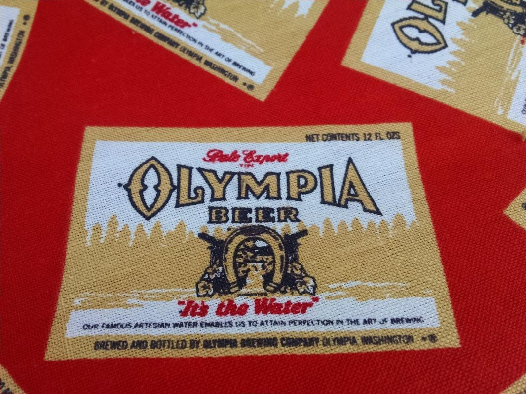 OLY OLYMPIA BEER FABRIC CURTAIN TABLECLOTH RETRO ERA RED GOLD WASHINGTON STATE USA BREWERY LOGO CERVEZA ADVERTISING TEXTILE GARMENT MATERIAL