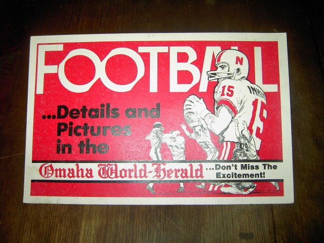 FOOTBALL SIGN OMAHA NEBRASKA WORLD HERALD NEWSPAPER BANNER RED WHITE CARDBOARD
