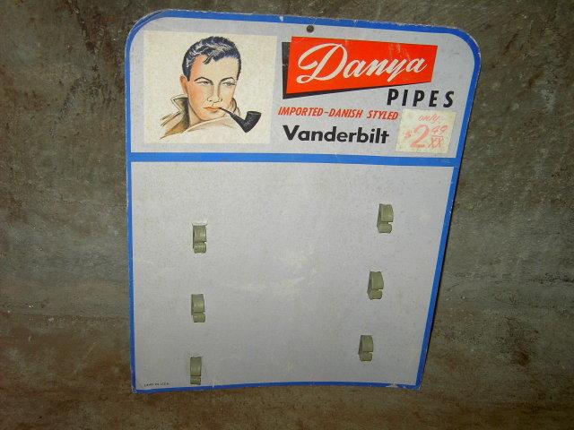 DANYA VANDERBILT IMPORTED DANISH STYLE PIPE BOARD STORE DISPLAY CARD CARDBOARD ADVERTISING SIGN