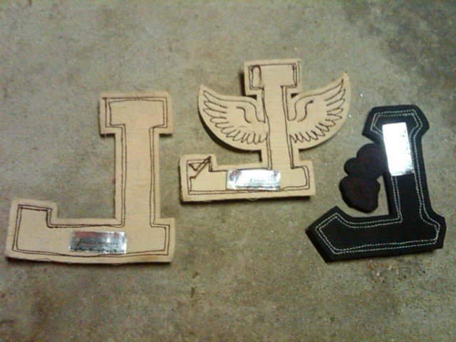 VARSITY LETTER L HIGH SCHOOL JACKET GARMENT APPAREL PATCH THEATRE BASKETBALL TRACK FIELD WINGS LOWE CAMPBELL ATHLETIC GOODS STICKER TAG