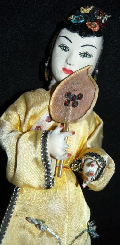 Chinese Cloth Doll representing the Qing period  Hand painted face, glass beads and silk