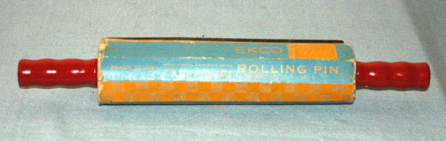 Red Handle rolling pin in org. packaging