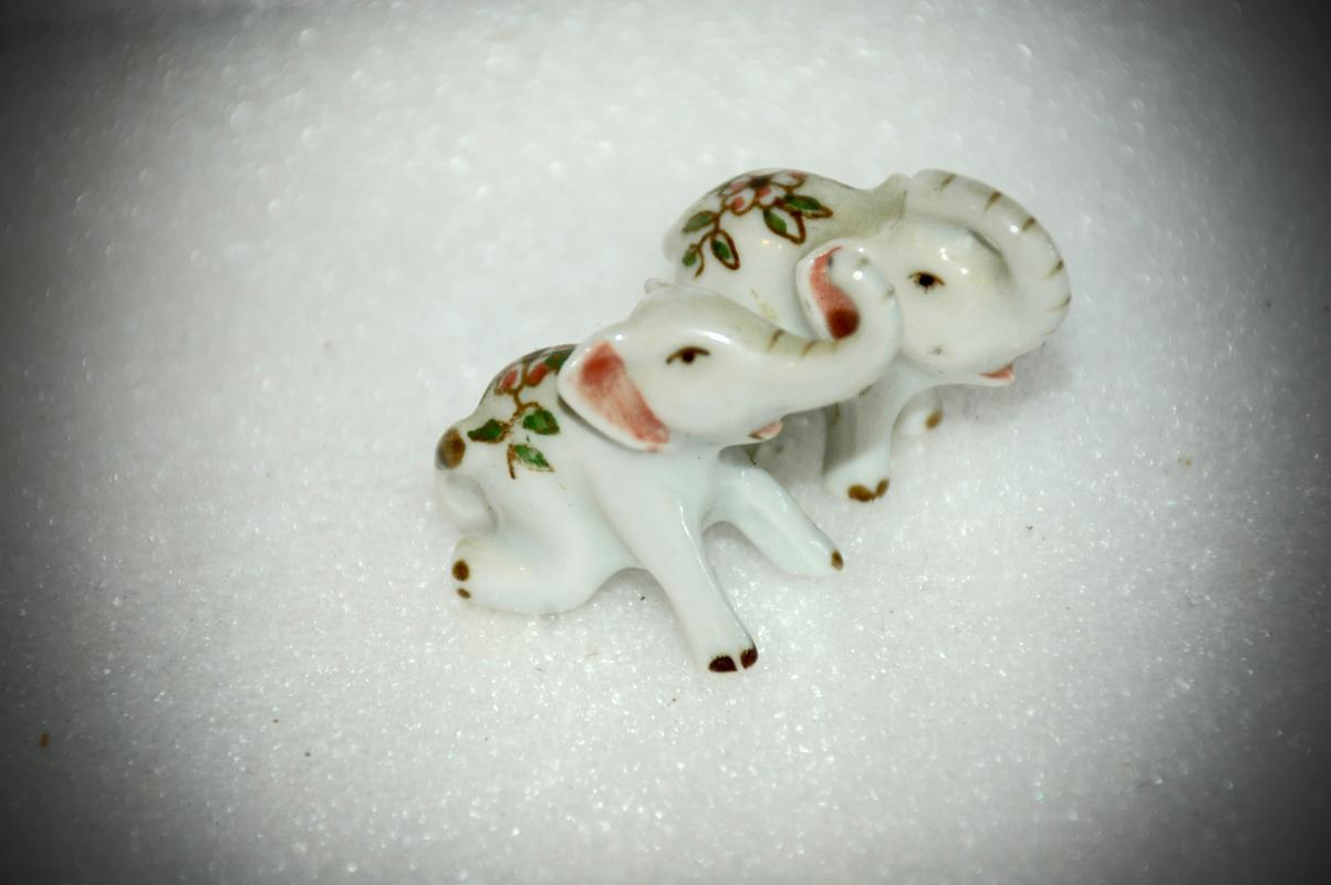 2  Tiny Porcelain Elephants Hand Painted Flowers and Gold Trim