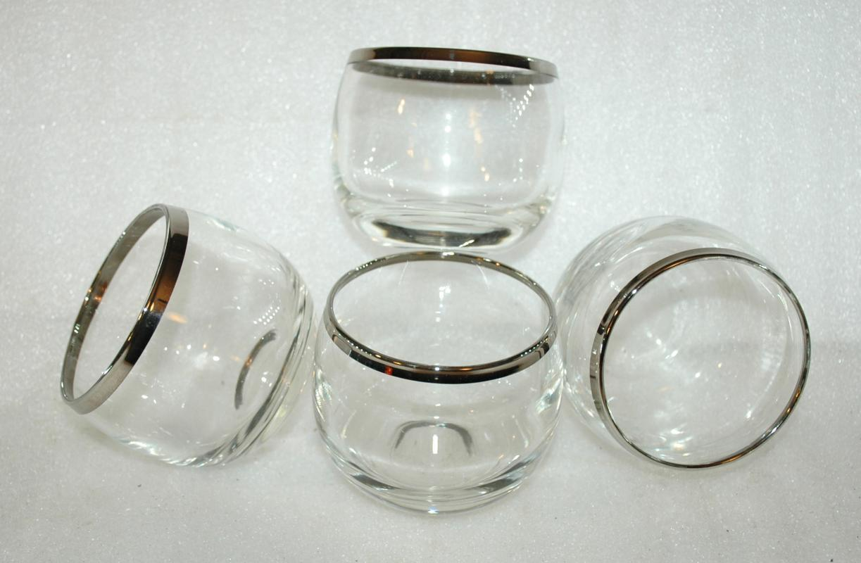 4  vintage Roly Poly silver rimmed drinking glasses from the 1960s