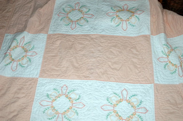 Hand Stitched Quilt with Embroidered Patterns