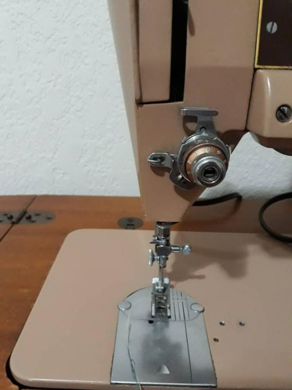 Vintage Singer Sewing Machine Slant  401A   with Knee control in Cabinet plus accessories.