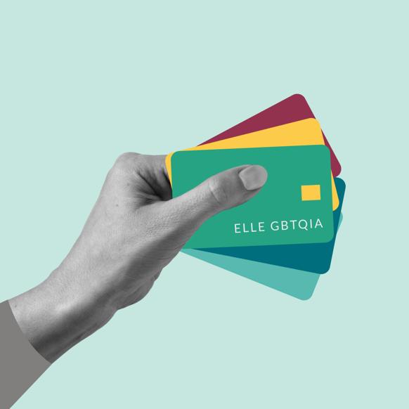"A hand holds five debit cards that read, ""ELLE GBTQIA."""