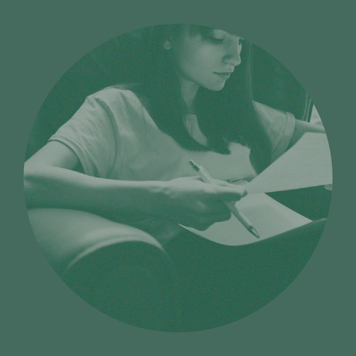 A photo of a woman sitting in a chair with papers on her lap and a pencil in her hand.