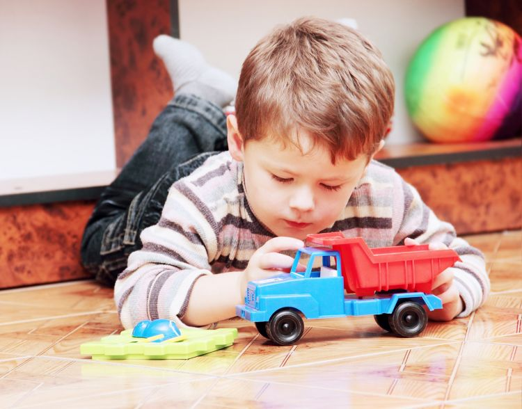 Boy Playing With Truck Single