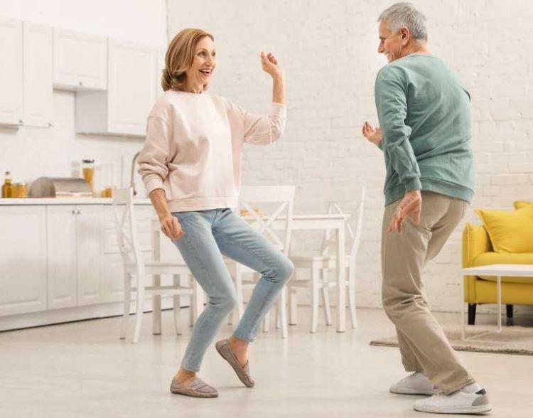Older Couple Dancing In Kitchen